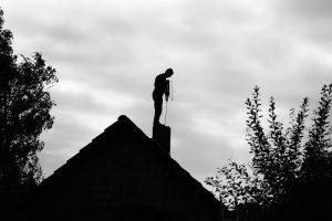 man-shadow-chimney-clean