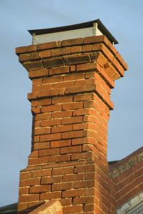 chimney-masonry-worn-brick