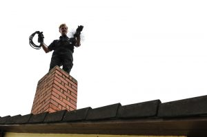 chimney-sweep-cleaning-chimney